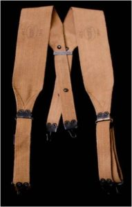 Model 1910 suspenders were used to hold up and distribute the weight of the cartridge belt. The hooks on the ends of the straps fit into the grommets on the belt. Marked Oct./Russell/1918.