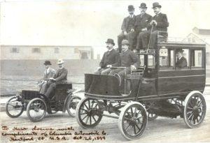 Visiting German Businessmen Driving Electric Omnibus